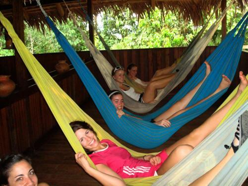 Visiting the Amazon in Ecuador: Resting in hamacs at the Cuyabeno Lodge when visiting the Amazon in Ecuador.