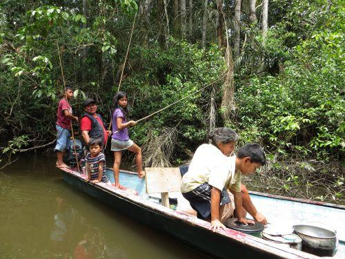 CUYABENO NATIONAL RESERVE [ECUADOR's AMAZON]:  Indian family out fishing.