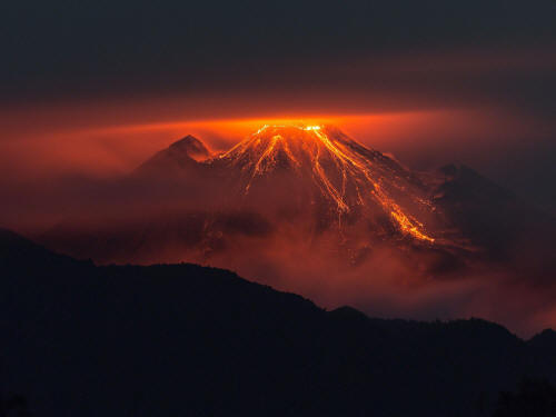The Reventador Volcano pouring out lava.