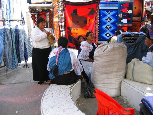 51 BEST NATIONAL PARKS OF ECUADOR [AND NATURE RESERVES]: Otavalo women at the Plaza de los Ponchos, Otavalo, Ecuador